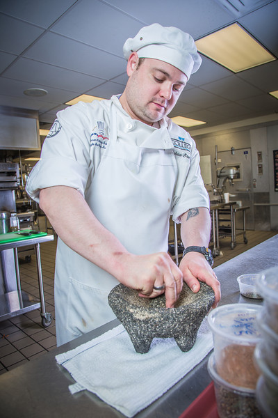 """Joshua Broda grinds fresh pepper the old fashioned way with morter and pestle in CTC's culinary arts kitchen in the Hutchison Center.  <div class=""""ss-paypal-button"""">Filename: AAR-13-3811-210.jpg</div><div class=""""ss-paypal-button-end"""" style=""""""""></div>"""