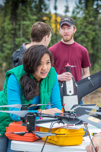 Students take part in a project using unmaned aerial vehicles (UAVs) at Poker Flat Research Range about 40 miles northeast of the Fairbanks campus. (Note: Taken as part of commercial shoot with Nerland Agency. Pretend class -- use with discretion!)  Filename: AAR-12-3560-078.jpg