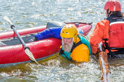 Staff members and graduate students from the Water and Environmental Research Center (WERC) and the Institute of Northern Engineering (INE) receive swiftwater rescue and safety training in the Chena River.  Filename: AAR-13-3813-186.jpg