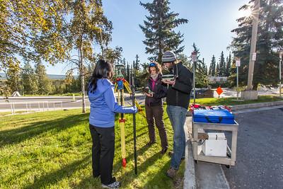 Associate professor Margaret Darrow, center, tests new field equipment with associates outside the Duckering Building on the Fairbanks campus.  Filename: AAR-14-4292-47.jpg