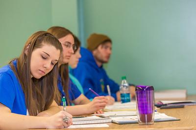 Schoof of Management students Sophie Marcinkowski, Emily Blanchard, Emily Ahem and Brennan LaBuda take notes in their intermediate accounting class.  Filename: AAR-14-4112-62.jpg