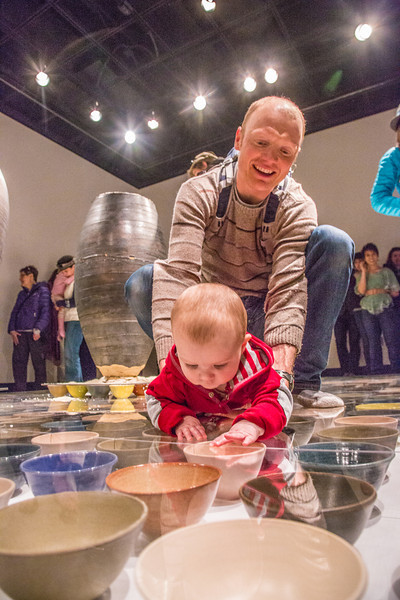 """Patrons of all ages walked or crawled around on the ceramic artwork produced by Ian Wilkinson for his BFA thesis during the opening of his show in the gallery in the UAF Fine Arts Complex.  <div class=""""ss-paypal-button"""">Filename: AAR-13-3780-386.jpg</div><div class=""""ss-paypal-button-end"""" style=""""""""></div>"""