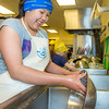 "Bridget Charlie takes a turn cleaning up at the UAF Summer Sessions Baking Blitz during the last week in May in the Hutchison kitchen.  <div class=""ss-paypal-button"">Filename: AAR-14-4203-26.jpg</div><div class=""ss-paypal-button-end""></div>"