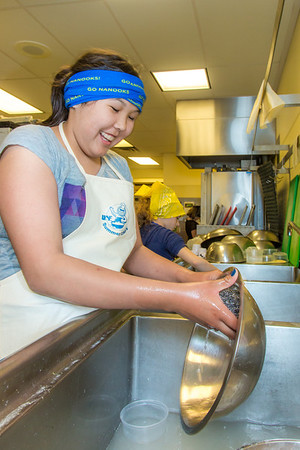 Bridget Charlie takes a turn cleaning up at the UAF Summer Sessions Baking Blitz during the last week in May in the Hutchison kitchen.  Filename: AAR-14-4203-26.jpg