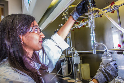 Graduate student Shruti Oza sets up apparatus for a procedure in UAF's Petroleum Development Lab in the Duckering Building.  Filename: AAR-13-3918-174.jpg