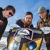 "Clean Snowmachine team members Ben Neubauer, left, Isaac Thompson, center, and Karlin Swearingen check out their machine after it's return  to campus after taking top honors in the Society of Automotive Engineers' Clean Snowmobile Challenge in Houghton, Mich.  <div class=""ss-paypal-button"">Filename: AAR-12-3337-33.jpg</div><div class=""ss-paypal-button-end"" style=""""></div>"