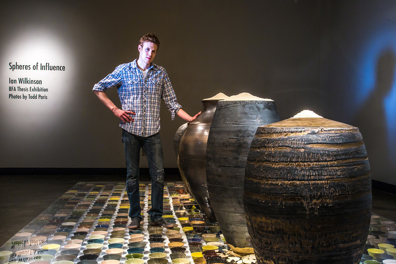 """Art major Ian Wilkinson poses by one of his ceramic pieces in the UAF Fine Arts gallery. His BFA thesis project, Spheres of Influence, raised more than $18,000 for the Fairbanks Food Bank through the sale of his 1,200 bowls.  <div class=""""ss-paypal-button"""">Filename: AAR-13-3775-144.jpg</div><div class=""""ss-paypal-button-end"""" style=""""""""></div>"""