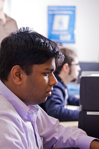 Rijo Simon works on some tricky code during his computer science class in the Chapman Building ASSERT lab.  Filename: AAR-12-3272-32.jpg