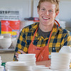"""Art major Ian Wilkinson poses with a few of the approximately 1,000 ceramic bowls needed for his senior thesis project in the fine arts complex on the Fairbanks campus.  <div class=""""ss-paypal-button"""">Filename: AAR-12-3547-102.jpg</div><div class=""""ss-paypal-button-end"""" style=""""""""></div>"""