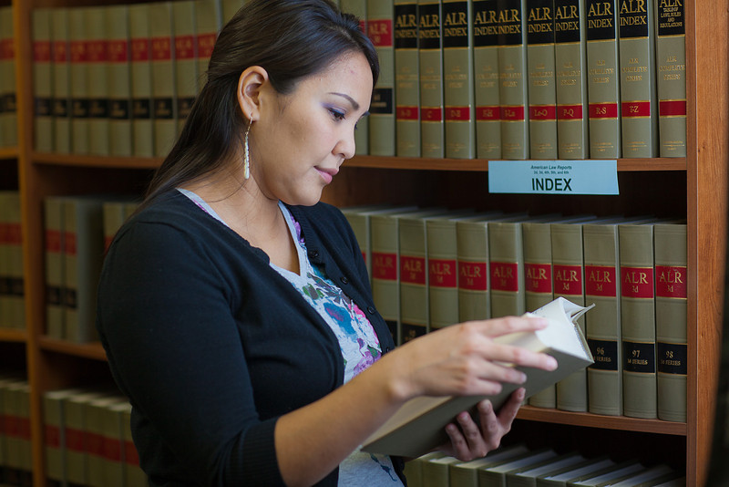 """Melissa Charlie conducts some research for her paralegal studies class in the law library at CTC's law library.  <div class=""""ss-paypal-button"""">Filename: AAR-11-3225-65.jpg</div><div class=""""ss-paypal-button-end"""" style=""""""""></div>"""
