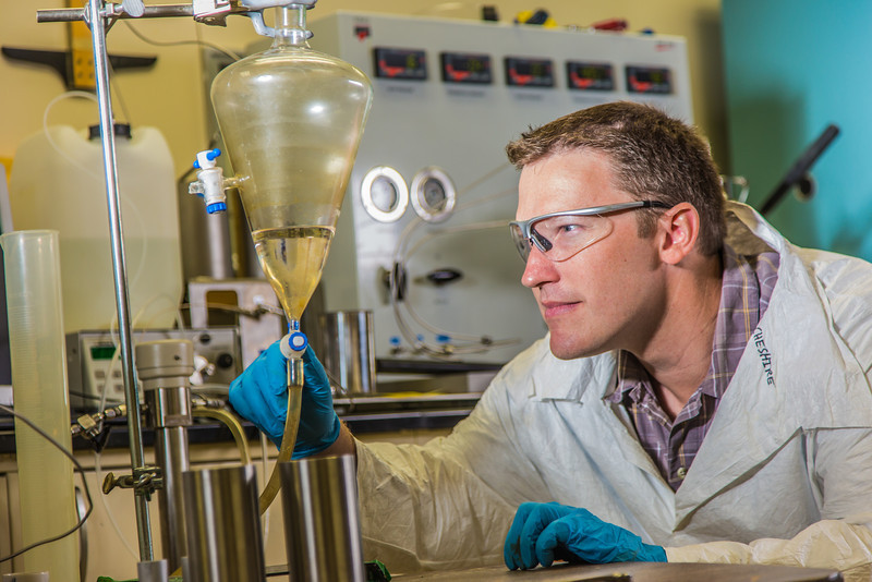 """Undergraduate John Cheshire conducts research in UAF's Petroleum Development Lab in the Duckering Building.  <div class=""""ss-paypal-button"""">Filename: AAR-13-3918-247.jpg</div><div class=""""ss-paypal-button-end"""" style=""""""""></div>"""
