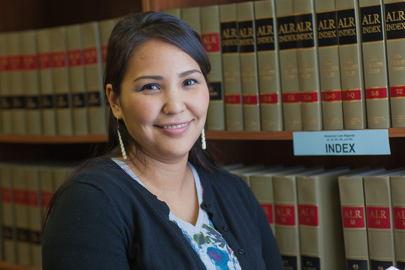 """Melissa Charlie conducts some research for her paralegal studies class in the law library at CTC's law library.  <div class=""""ss-paypal-button"""">Filename: AAR-11-3225-72.jpg</div><div class=""""ss-paypal-button-end"""" style=""""""""></div>"""