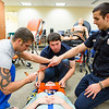 "EMT students from left: Floyd Lewis, Quinten Johnson and Michael Bellia provide medical attention for training purposes to fellow student Claire Todd during class at the UAF Community & Technical College.  <div class=""ss-paypal-button"">Filename: AAR-12-3444-11.jpg</div><div class=""ss-paypal-button-end"" style=""""></div>"