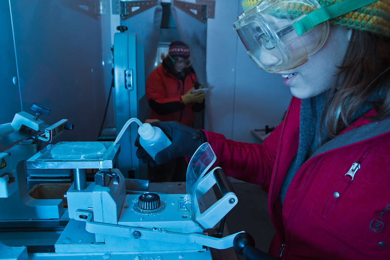 """In temperatures hovering near -10°, sophomore Tiffany Green prepares a thin slice of ice for inspection of its crystal formation during a lab exercise in Prof. Erin Pettit's Ice in Climate Systems class in the Elvey Building's ice lab.  <div class=""""ss-paypal-button"""">Filename: AAR-12-3330-025.jpg</div><div class=""""ss-paypal-button-end"""" style=""""""""></div>"""