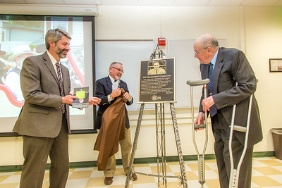 Professor of Engineering Emeritus Bill Mendenhall, right, helps unveil a plaque during a ceremony in which a Duckering Building classroom was named in his honor.  Filename: AAR-14-4181-65.jpg