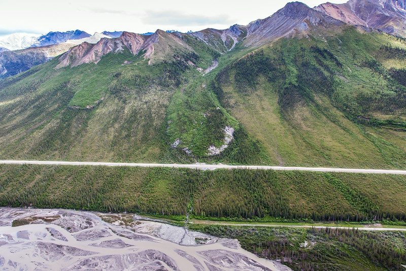 """This photo shows three of several frozen debris lobes which are moving at various speeds down the hillsides along the Dietrich River valley in the southern Brooks Range, posing a serious threat to the Dalton Highway and Trans-Alaska Pipeline.  <div class=""""ss-paypal-button"""">Filename: AAR-14-4219-105.jpg</div><div class=""""ss-paypal-button-end""""></div>"""