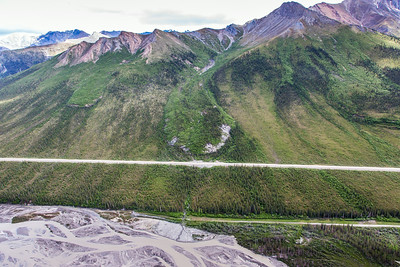 This photo shows three of several frozen debris lobes which are moving at various speeds down the hillsides along the Dietrich River valley in the southern Brooks Range, posing a serious threat to the Dalton Highway and Trans-Alaska Pipeline.  Filename: AAR-14-4219-105.jpg