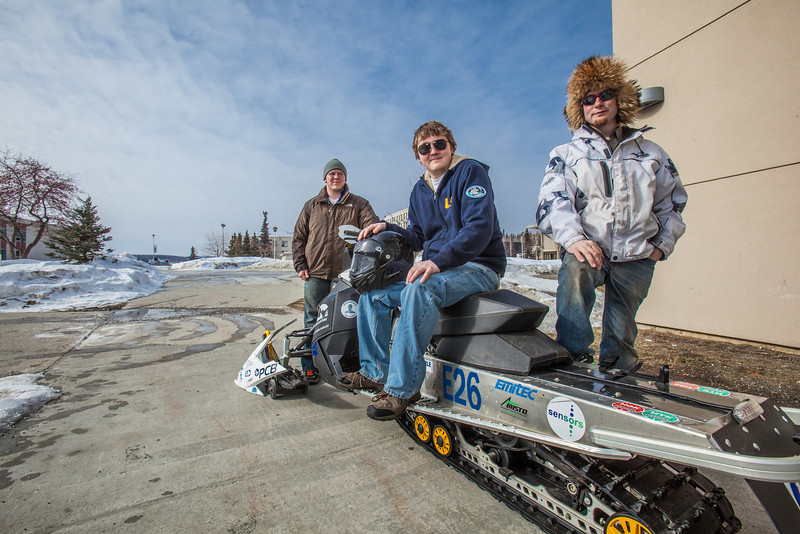 """Team members Karlin Swearingen, left, Ben Neubauer, center, and Isaac Thompson stand with their winning entry in the 2012 SAE Clean Snowmobile Challenge.  <div class=""""ss-paypal-button"""">Filename: AAR-12-3345-030.jpg</div><div class=""""ss-paypal-button-end"""" style=""""""""></div>"""