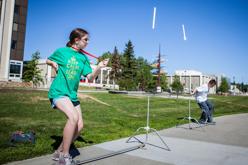 """Middle school students try various rocket designs outdoors during the Alaska Summer Research Academy.  <div class=""""ss-paypal-button"""">Filename: AAR-13-3862-11.jpg</div><div class=""""ss-paypal-button-end"""" style=""""""""></div>"""