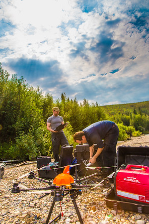 "Carl France, left, and Trevor Parcell with the Alaska Center for Unmanned Aircraft Systems Integration (ACUASI) set up a piloting station on a gravel bar along the upper Chena River. The UAV pilots were taking part in a joint effort with the U.S. Fish and Wildlife Service to collect video of important king salmon spawning habitat.  <div class=""ss-paypal-button"">Filename: AAR-15-4593-083.jpg</div><div class=""ss-paypal-button-end""></div>"