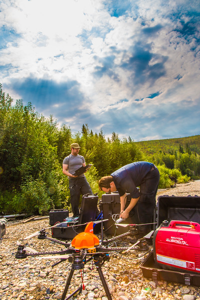 """Carl France, left, and Trevor Parcell with the Alaska Center for Unmanned Aircraft Systems Integration (ACUASI) set up a piloting station on a gravel bar along the upper Chena River. The UAV pilots were taking part in a joint effort with the U.S. Fish and Wildlife Service to collect video of important king salmon spawning habitat.  <div class=""""ss-paypal-button"""">Filename: AAR-15-4593-083.jpg</div><div class=""""ss-paypal-button-end""""></div>"""