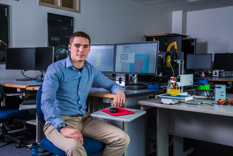 """Mechanical engineeering major Daniel Doughterty poses in UAF's Community and Technical College's 3-D print lab in downtown Fairbanks.  <div class=""""ss-paypal-button"""">Filename: AAR-16-4857-172.jpg</div><div class=""""ss-paypal-button-end""""></div>"""