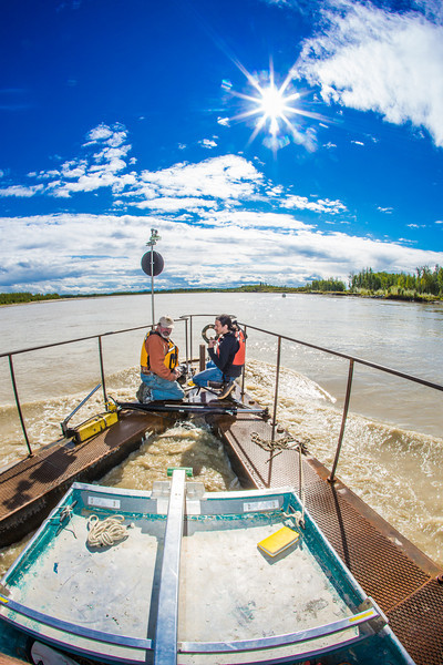 "Jack Schmid, left, and Paul Duvoy, research professionals with the Alaska Center for Energy and Power, take measurements on a prototype deployment boom on the Tanana River near Nenana. The pair are part of a team conducting research on the feasibility of using the river current to generate electricity for potential use throughout rural Alaska.  <div class=""ss-paypal-button"">Filename: AAR-12-3500-061.jpg</div><div class=""ss-paypal-button-end"" style=""""></div>"