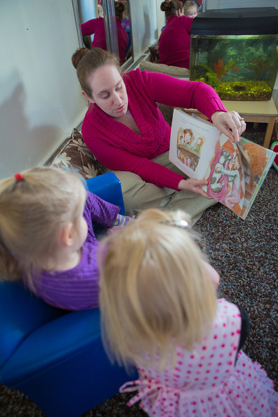 """Heather Pearce works with pre-schoolers at the Bunnell House on the UAF campus as part of her internship for a degree in early childhood development.  <div class=""""ss-paypal-button"""">Filename: AAR-12-3335-048.jpg</div><div class=""""ss-paypal-button-end"""" style=""""""""></div>"""