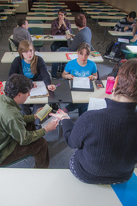 Professor Alexandra Fitts works with small groups of students in her Hispanic Theater class during a recent meeting in the Gruening Building.  Filename: AAR-12-3350-44.jpg