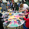 "Children build paper rockets during the annual Eweek open house in the Duckering Building on campus.  <div class=""ss-paypal-button"">Filename: AAR-14-4081-96.jpg</div><div class=""ss-paypal-button-end""></div>"