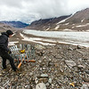 "Matvey Debolskiy, a Ph.D. student in geophysics, balances a precipitation gauge on a ridge above the Jarvis Glacier in the eastern Alaska Range.  <div class=""ss-paypal-button"">Filename: AAR-14-4256-303.jpg</div><div class=""ss-paypal-button-end""></div>"