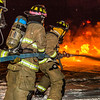 "Student firefighters with the University Fire Department spray water on a blaze of burning fuel during a live training drill at the Fairbanks International Airport.  <div class=""ss-paypal-button"">Filename: AAR-13-3995-180.jpg</div><div class=""ss-paypal-button-end"" style=""""></div>"