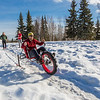 "Mechanical engineering majors Daniel Sandstrom, left, Eric Bookless and Neil Gotschall, front, demonstrate their fat tire ski bike they designed and built for paraplegic users as their spring 2016 senior design project. The bike is powered by pushing and pulling on the handles.  <div class=""ss-paypal-button"">Filename: AAR-16-4856-05.jpg</div><div class=""ss-paypal-button-end""></div>"