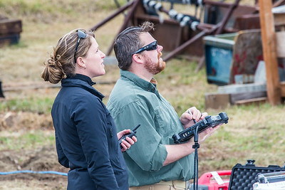 Pilots Jennifer Haney, left, and Mike Cook operate the controls of the Aeryon Scout quadcopter as it takes off on an historic flight at UAF's Large Animal Research Station.  Filename: AAR-14-4172-106.jpg