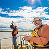 "Jack Schmid, front, and Paul Duvoy, research professionals with the Alaska Center for Energy and Power, record measurements on a prototype deployment boom on the Tanana River near Nenana. The pair are part of a team conducting research on the feasibility of using the river current to generate electricity for potential use throughout rural Alaska.  <div class=""ss-paypal-button"">Filename: AAR-12-3500-044.jpg</div><div class=""ss-paypal-button-end"" style=""""></div>"