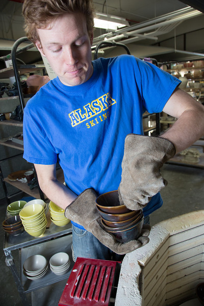 "Art major Ian Wilkinson removes some of the 1,000-plus same-sized bowls he made for his senior thesis from a kiln in the UAF ceramics studio.  <div class=""ss-paypal-button"">Filename: AAR-13-3744-17.jpg</div><div class=""ss-paypal-button-end"" style=""""></div>"