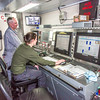 "Engineers Steve Walsh, left, and Jean Lavache monitor activity throughout the ship from a control room on board the R/V Sikuliaq while the ship was docked in Juneau during a stopover on its inaugural voyage to its home port of Seward in Feb., 2015.  <div class=""ss-paypal-button"">Filename: AAR-15-4456-256.jpg</div><div class=""ss-paypal-button-end""></div>"