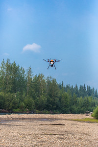 An unmanned aerial vehicle (UAV) stands ready to collect video of important king salmon spawning habitat along a popular stretch of the upper Chena River about 40 miles northeast of Fairbanks. The project was a collaboration between the Alaska Center for Unmanned Aircraft Systems Integration (ACUASI) and the U.S. Fish and Wildlife Service.  Filename: AAR-15-4593-267.jpg