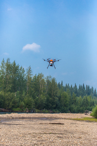 "An unmanned aerial vehicle (UAV) stands ready to collect video of important king salmon spawning habitat along a popular stretch of the upper Chena River about 40 miles northeast of Fairbanks. The project was a collaboration between the Alaska Center for Unmanned Aircraft Systems Integration (ACUASI) and the U.S. Fish and Wildlife Service.  <div class=""ss-paypal-button"">Filename: AAR-15-4593-267.jpg</div><div class=""ss-paypal-button-end""></div>"