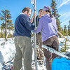 "Research associate professor Javier Fochesatto, left, ACEP intern Luke George, and Daisy Huang, a research engineer for the Alaska Center for Energy and Power, set up a remote meteorological station on a hillside near the Black Rapids Lodge, about 150 miles southeast of Fairbanks. The station will record wind speed and direction, as well as temperatures at different altitudes.  <div class=""ss-paypal-button"">Filename: AAR-13-3843-147.jpg</div><div class=""ss-paypal-button-end"" style=""""></div>"