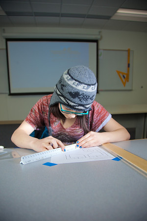 Michelle Kubo works through her assignment in her drafting class at UAF's Community and Technical College.  Filename: AAR-11-3221-05.jpg