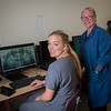 "UAF Community and Technical College assistant professor Jenifer Filotei and student Lauren Slater study a computer image of a radiograph x-ray at the school's facility on Barnette Street in downtown Fairbanks.  <div class=""ss-paypal-button"">Filename: AAR-16-4873-173.jpg</div><div class=""ss-paypal-button-end""></div>"