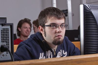 Syler Clayton studies the monitor during his computer programming class.  Filename: AAR-12-3272-10.jpg