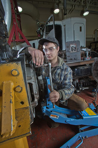 George Jensen disassembles a transmission in the diesel mechanics lab at the Hutchison Institute of Technology.  Filename: AAR-12-3312-072.jpg