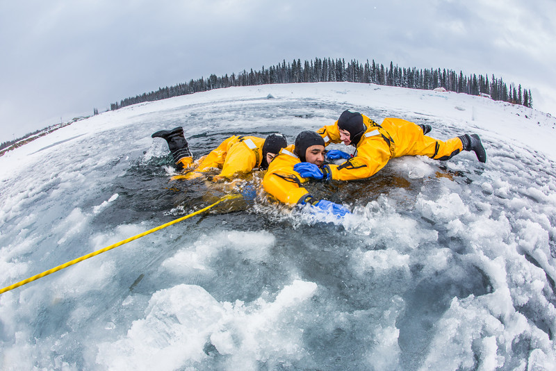 """Student firefighters practice cold-water rescue techniques at a pond near the Fairbanks campus.  <div class=""""ss-paypal-button"""">Filename: AAR-13-3797-34.jpg</div><div class=""""ss-paypal-button-end"""" style=""""""""></div>"""