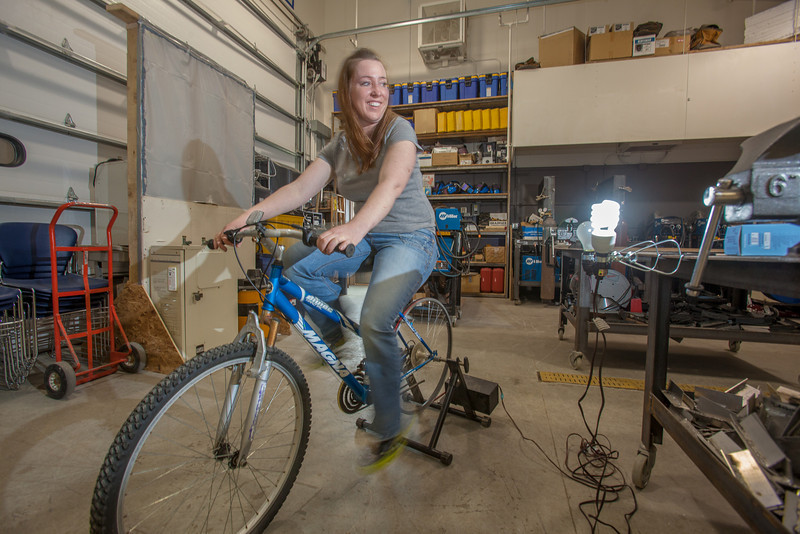 """In Dillingham, students at UAF's Bristol Bay Campus learn to relate to how much energy it takes to power a light bulb with pedal power.  <div class=""""ss-paypal-button"""">Filename: AAR-12-3390-121.jpg</div><div class=""""ss-paypal-button-end"""" style=""""""""></div>"""