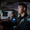 "UAF student firefighters/EMTs Lillian Hampton and Paul Young prepare to respond to an emergency call from the front of an ambulance housed in the Whitaker Building on the Fairbanks campus.  <div class=""ss-paypal-button"">Filename: AAR-11-3223-81.jpg</div><div class=""ss-paypal-button-end"" style=""""></div>"