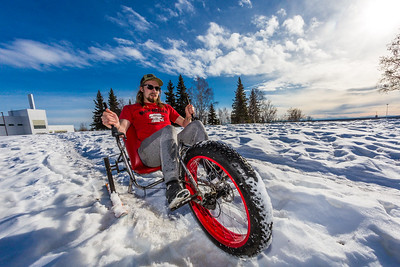 Mechanical engineering major Eric Bookless demonstrates the fat tire ski bike he and two partners designed and built for paraplegic users as their spring 2016 senior design project. The bike is powered by pushing and pulling on the handles.  Filename: AAR-16-4856-37.jpg