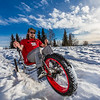 "Mechanical engineering major Eric Bookless demonstrates the fat tire ski bike he and two partners designed and built for paraplegic users as their spring 2016 senior design project. The bike is powered by pushing and pulling on the handles.  <div class=""ss-paypal-button"">Filename: AAR-16-4856-37.jpg</div><div class=""ss-paypal-button-end""></div>"