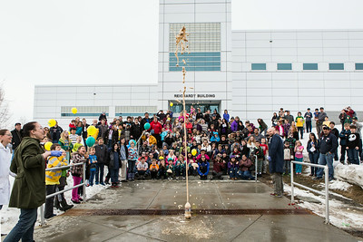 Youngsters and their parents react to a explosion demonstration during the Science Potpourri event at the Reichardt Building.  Filename: AAR-14-4141-170.jpg